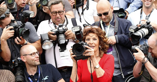 CANNES WATCH: Loren's curves; downtime for Lutz